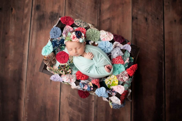 Baby girl in vintage quilt. Emily Robin Photography. Wyoming Newborn photography. Montana newborn photography. Fine art newborn portraiture. Premier Newborn Photography.