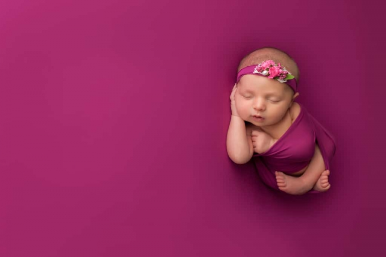Newborn baby girl in bold pink. Emily Robin Photography. Wyoming Newborn photography. Montana newborn photography. Fine art newborn portraiture. Premier Newborn Photography.